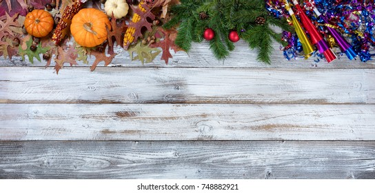 Year end seasonal decorations in top border on rustic white wooden boards