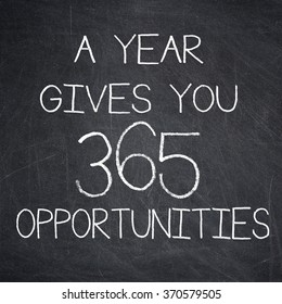 A YEAR GIVES YOU 365 OPPORTUNITIES motivational quote written on a blackboard