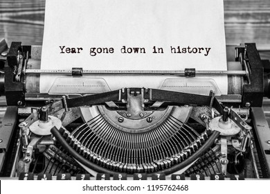 year gone down in history, text on a vintage typewriter, in black ink on old paper.
