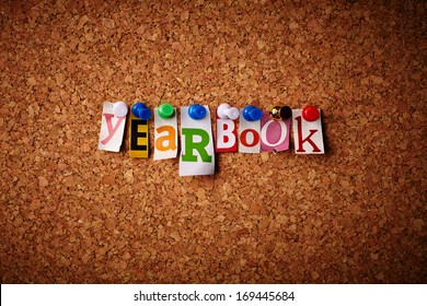 Yearbook - Cut out letters pinned on a cork notice board.