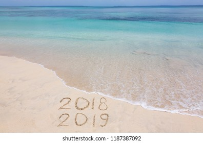 Years 2018 and 2019 are inscribed on sandy beach