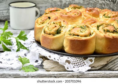 Yeast cake with cheese and herb on the rustic background.Selective focus.