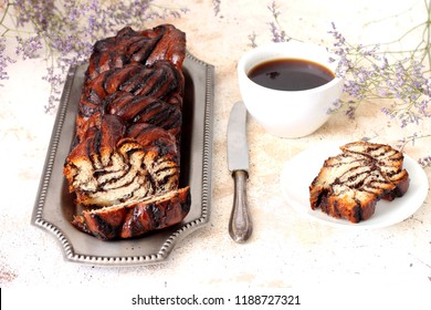 Yeast cake with chocolate and hot coffee