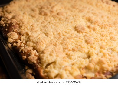 Yeast cake with crumbles on a tray