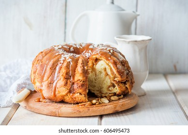 Yeast cake with nut filling and caramel sauce for Easter