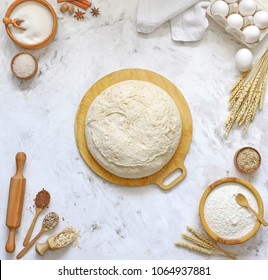 yeast dough with recipe dough bread, pizza or pie.  Ingredients on the background of the kitchen table flour, eggs, sugar, salt, seeds.