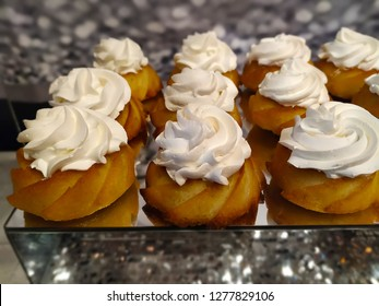 Yeasted Rum Cake (Sabrina Cake) with whipped cream. Festive gourmet dessert