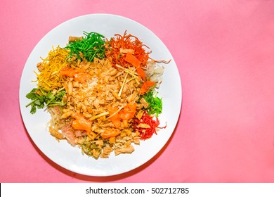 Yee Sang or Yusheng with raw salmon fillet, traditional Chinese New Year prosperity delicacies in Malaysia and Singapore