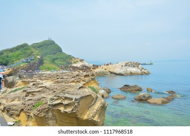 YEHLIU,TAIWAN, 22 may 2018: Many tourists watch the stone Strange shape at Yehliu Geopark,These rock caused by the erosion of sea waves