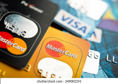 YEKATAERINBURG, RUSSIA - JAN 07, 2015: Pile of credit cards, Visa and MasterCard. Visa and Mastercard are a two biggest credit card companies in the world.