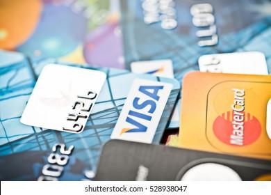 YEKATAERINBURG, RUSSIA - JAN 07, 2015: Pile of Visa credit cards. Visa is biggest credit card companie in the world.