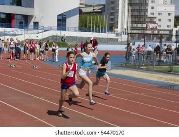 YEKATERINBURG - JUNE 2: regional competition in Athletics Champion Juniors of Urals, young women athletes running around the stadium Dynamo. Event june 2, 2010 in Yetaterinburg, Russia.