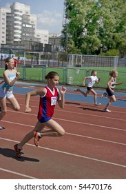 YEKATERINBURG - JUNE 2: regional competition in Athletics Champion Juniors of Urals, young women athletes running around the stadium Dynamo. Event june 2, 2010 in Yetaterinburg, Russia.