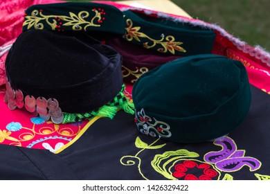 Yekaterinburg, Russia - 06.15.2019: Sabantuy, national costume skullcap Bashkirs and Tatars. exhibit at the street exhibition.