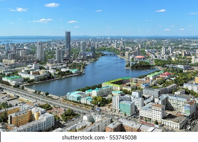 YEKATERINBURG, RUSSIA - AUGUST 19, 2016: View of the city pond, historical center and Yekaterinburg-City district from the observation deck on the 52nd floor of Vysotsky skyscraper.