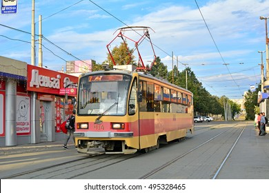 YEKATERINBURG, RUSSIA - AUGUST 28 - The 71-405 tram, produced by Uraltransmash since 2006, serving a stop by the Yekaterinburg (Sverdlovsk) railway station on August 28, 2016 in Yekaterinburg, Russia
