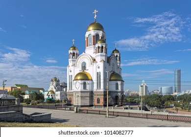 Yekaterinburg, Russia. Church on Blood in Honour of All Saints Resplendent in the Russian Land, and Patriarchal Metochion. The buildings of Yekaterinburg-City district are visible in the background.