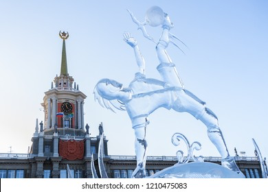 Yekaterinburg, Russia - January,13,2018: Icy figure of football player with ball on the Town Hall background, dedicated to 2018 Mundial.