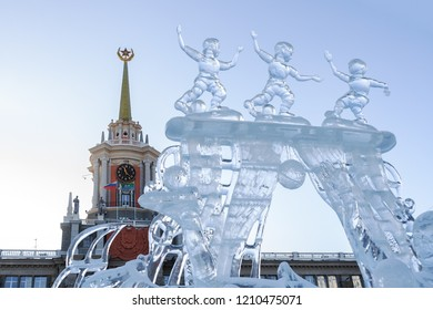 Yekaterinburg, Russia - January,13,2018: Icy sculpture of three football players with ball on the Town Hall background, dedicated to 2018 Mundial.