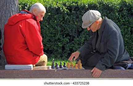 YEKATERINBURG, RUSSIA - JULY 20, 2015: men are playing chess outdoor in Yekaterinburg, Russia
