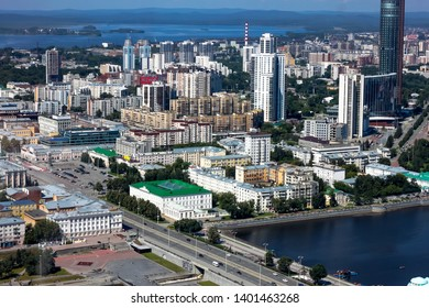 Yekaterinburg, Russia - june 14 2017: View of Yekaterinburg city landscape from Vysotsky skyscraper and Ekaterinburg . Stunning view of glass facade tall building and the river Iset