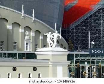 """Yekaterinburg, Russia - May 20, 2018:  """"Football players"""", sculpture at the East entrance of Ekaterinburg-Arena. Main entrance of the stadium. 4 games of the group stage 2018 World Cup."""