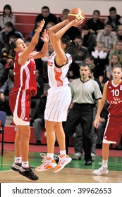 YEKATERINBURG, RUSSIA - OCT 28: TEO player, M.Bjelica (L) blocks attack of S.Abrosimova (UMMC) during the Euroleague 2009 basket game held on Oct 28, 2009 in Yekaterinburg, Russia. UMMC beat TEO, 85 to 56.