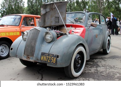 Yekaterinburg, Russia-June 12, 2015: Exhibition of retro cars. Opel Kadett Cabrio 1936. The inscription near the hole in the car in Russian: from the projectile