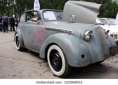 Yekaterinburg, Russia-June 12, 2015: Opel Kadett Cabrio 1936. On glass written: category 1, year issuing, engine. The inscription near the hole in the car: from a grenade. On the poster: Autoradio
