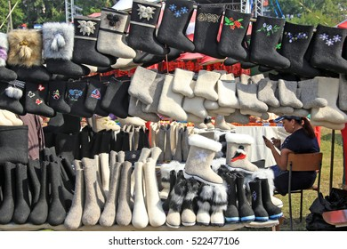Yelabuga, Russia - August 7, 2016: Annual IX All-Russia Spasskaya Fair, Various felt boots with handmade embroidery