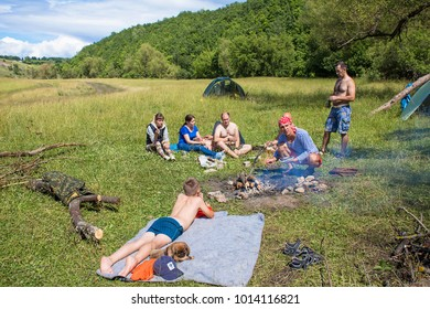 Yelets, Russia, July 2017:A large company of tourists are resting on a clearing, pitched a campsite,