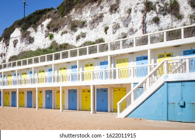 Yello and blue beach huts at Viking Bay, Broadstairs, Kent, UK, 3 July 2019. Traditional British seaside town.