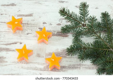 yellos star shaped candles with fir branch