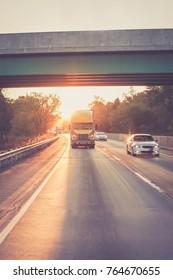 Yellow 18 wheeler truck on highway