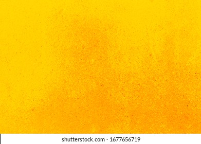 Yellow abstract background with granular surface. Wall texture with space for text design