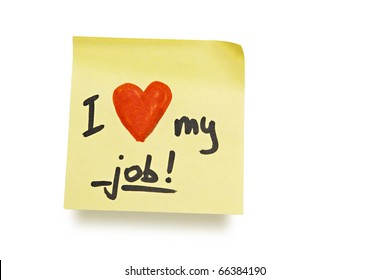 "yellow adhesive note on white background with ""i love my job"" note"