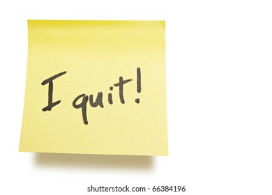 """yellow adhesive note on white background with """"i quit"""" note"""