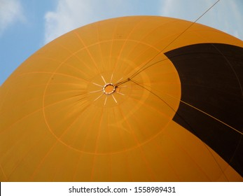 Yellow airballoon tethered ready for take-off