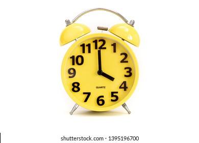 Yellow alarm clock on white at 4 o'clock