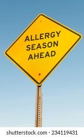 Yellow allergy season ahead highway road sign