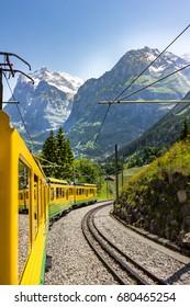 Yellow alpine train in Switzerland
