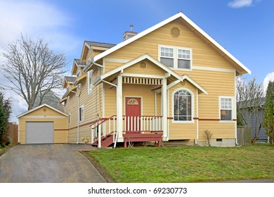 Yellow American home with red door
