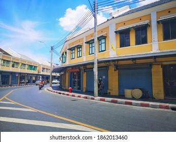 Yellow ancient shophouses on the side of the road, banglumpoo, bangkok, thailand, july 2020