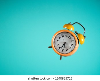Yellow ancient watch in blue background