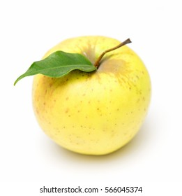 yellow apple with a leaf on a white background