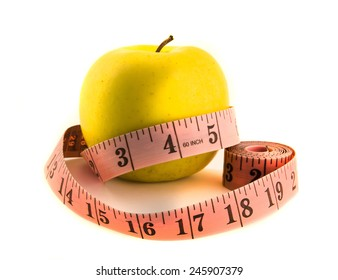 Yellow apple with tape measure. Isolated on white background