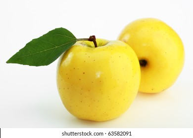 Yellow apples on a white background