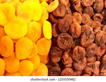 yellow apricot black apricot cut on plate next to each other yellow and black apricot beautifully stacked design made booth stand Malatya apricot day dry look great.