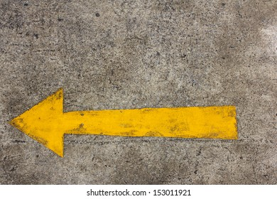 Yellow arrow left on asphalt street for the concept of choice