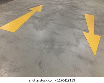 Yellow arrow on the floor. Up and down arrow.